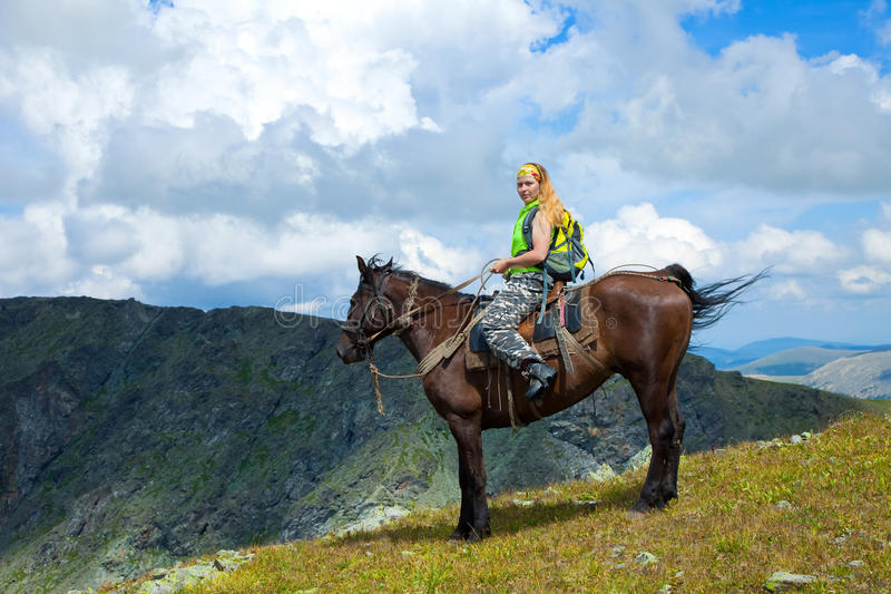 Female rider on horseback stock images