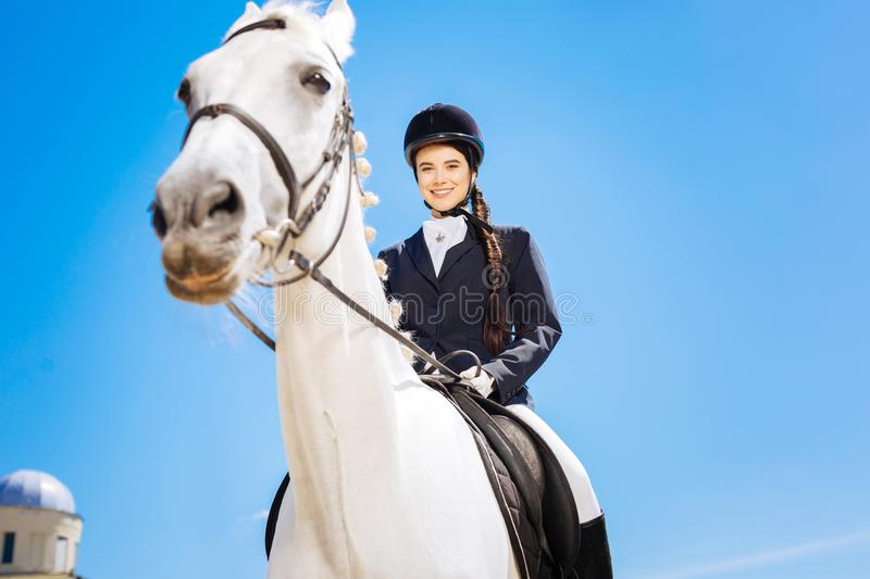 Female rider smiling after achieving good results in racing royalty free stock photography