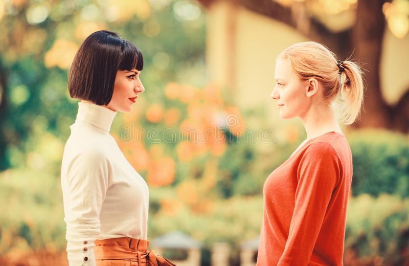 Female rivalry. Friendship problems rivalry and jealousy. Rivalry and leadership. Women looking at each other with stock images