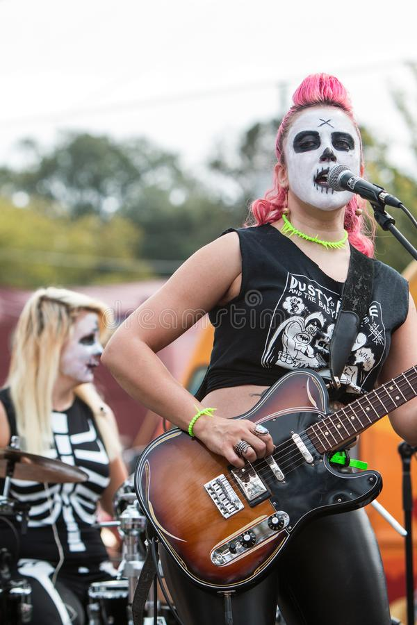 Female Rock Band Wearing Zombie Makeup Performs At Halloween Event royalty free stock image