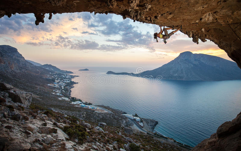 Female rock climber at sunset royalty free stock image