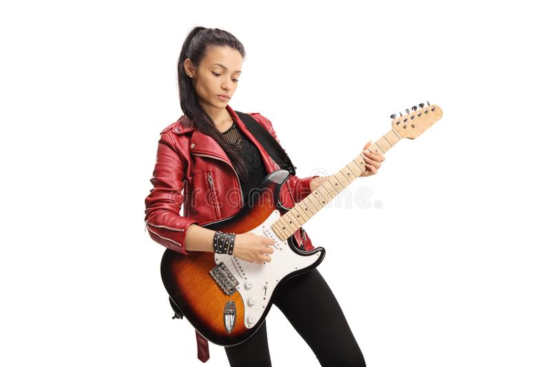 Female rock star playing a bass guitar royalty free stock photo