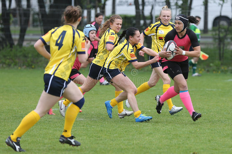 Female rugby players in action royalty free stock photo