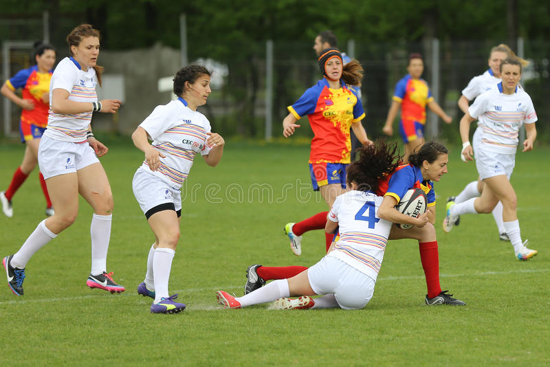 Female rugby players in action royalty free stock images