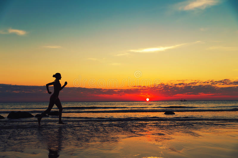Download Female Runing Along The Sea Coast Stock Photo - Image: 38960366