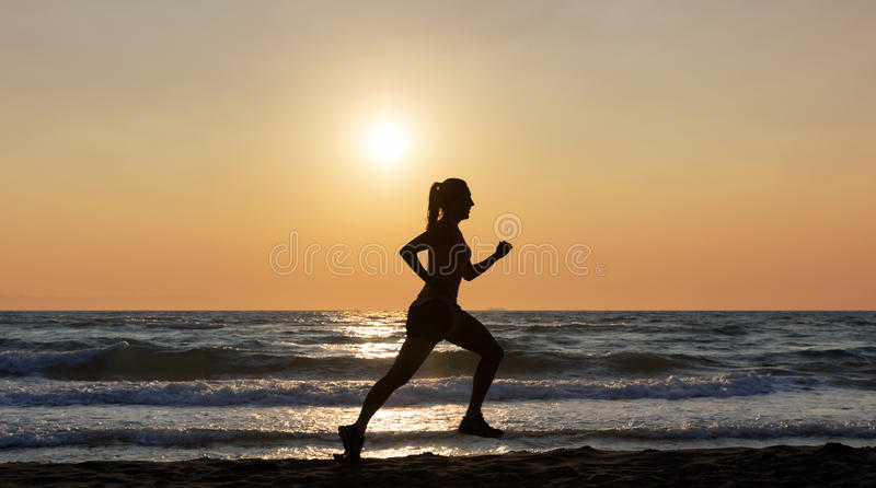 Female runner on beach stock images