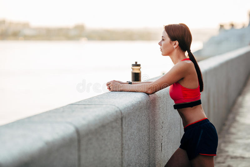 Female runner with bottled water stock photography