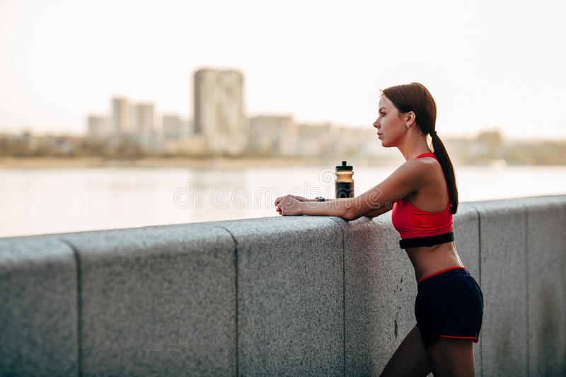 Female runner with bottled water royalty free stock photos