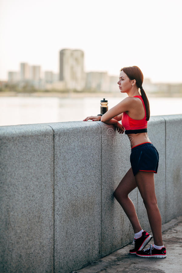 Female runner with bottled water stock photo