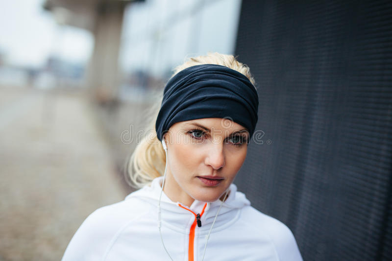 Female runner looking focused. Fitness woman looking focused while outdoors for training session. Female runner looking away stock photography