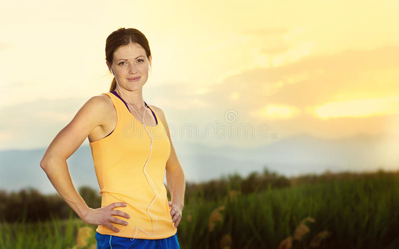 Female runner ready to run outdoors royalty free stock photos