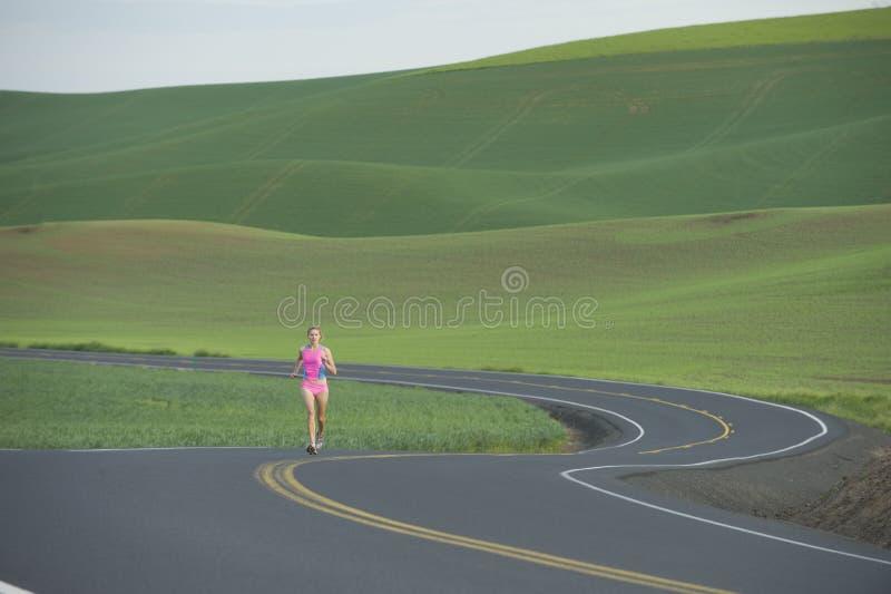 Female Runner on Rural Road royalty free stock photos