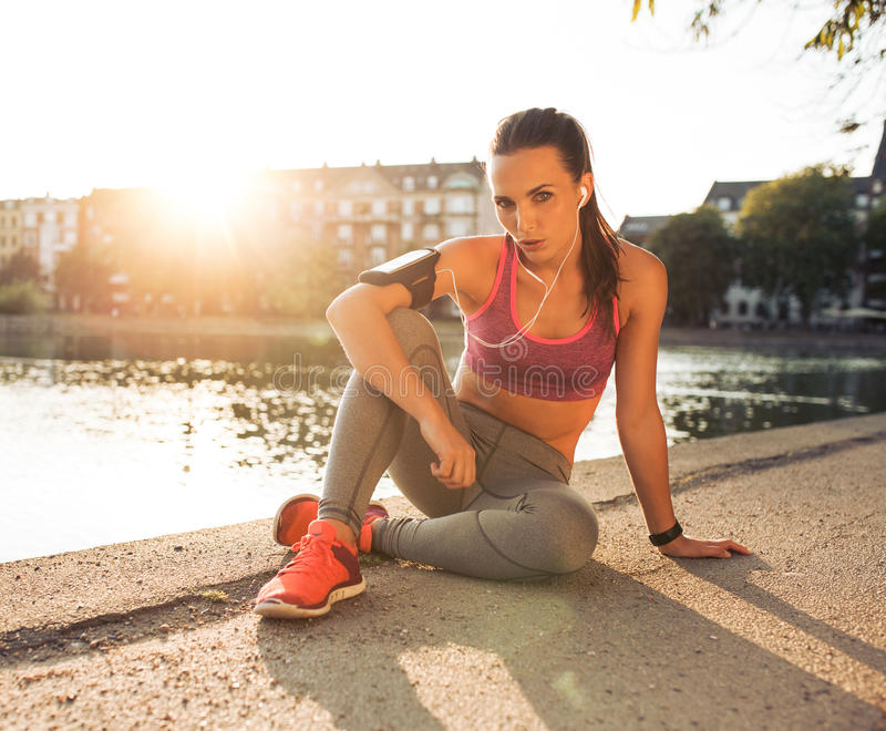 Female runner taking a rest from training stock images