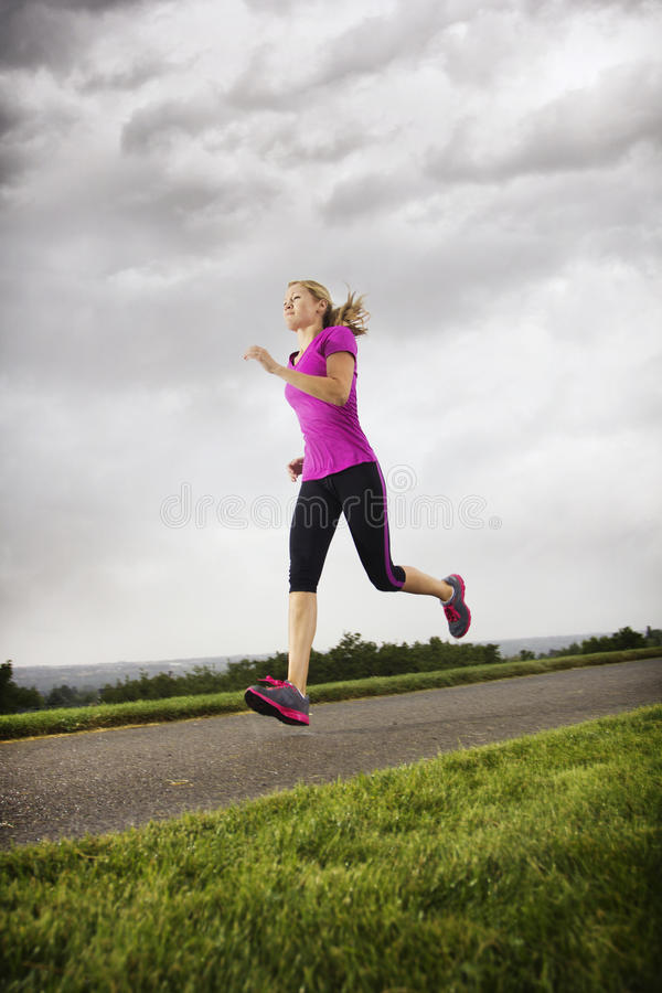 Female Runner Working Out On A Rainy Day Royalty Free Stock Photos