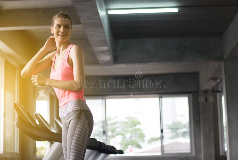 Female running on treadmills doing cardio training in a gym,Healthy lifestyle concept,Happy and smiling royalty free stock photos