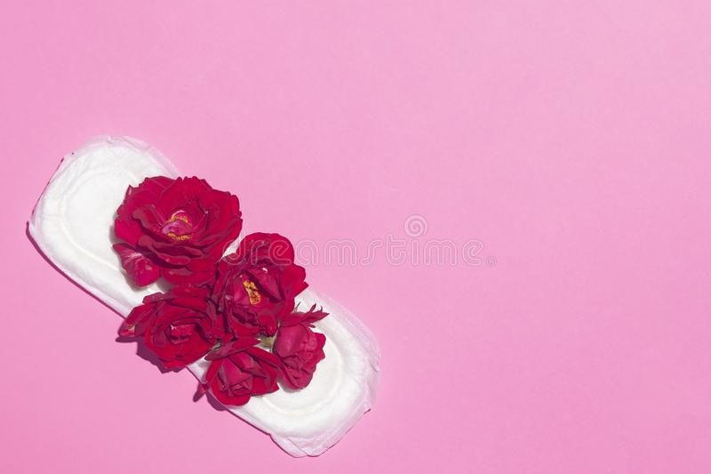 Female`s hygiene products on pink background. Concept of critical days, menstrual cycle, period days, PMS stock photo
