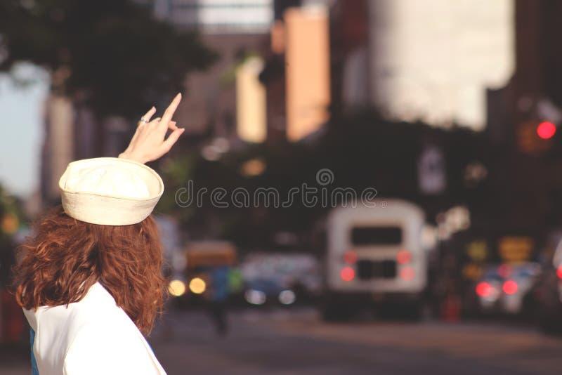 Female In Sailor Cap Hailing A Cab Free Public Domain Cc0 Image