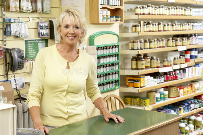 Female sales assistant in health food store stock photo