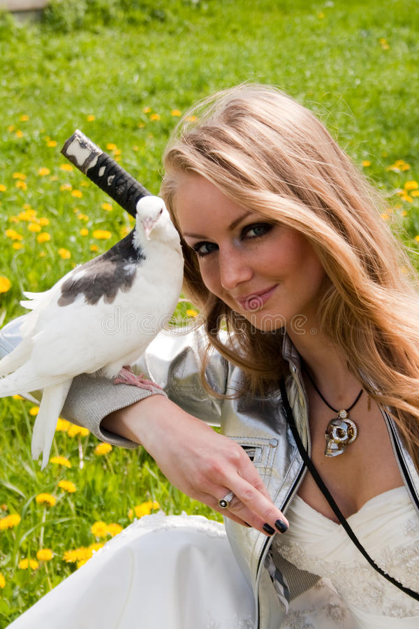 Female With Samurai Sword And Dove Royalty Free Stock Photos
