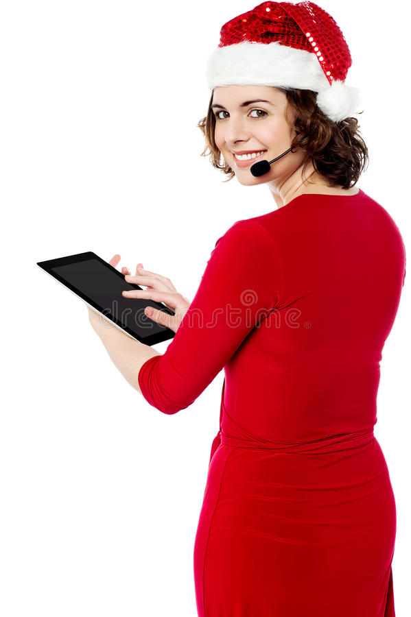 Download Female Santa Browsing On Her Tablet Pc Stock Image - Image: 34481485