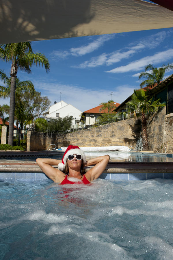Female Santa Claus Relaxing In Spa Stock Photos