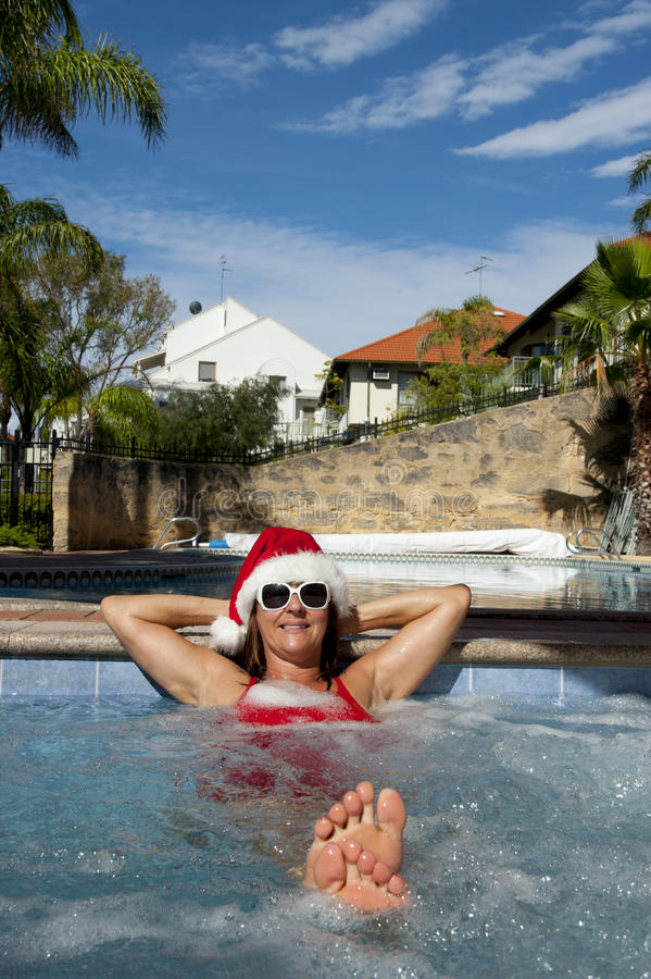Female Santa Claus relaxing in Spa stock photo