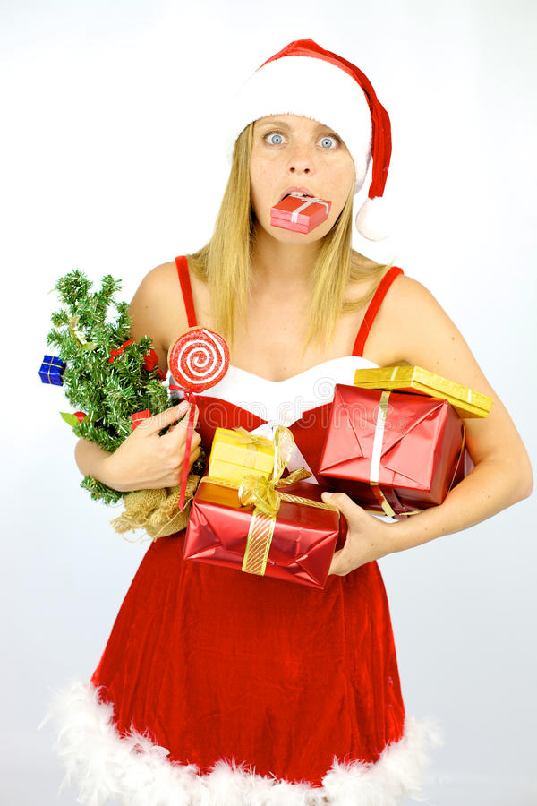 Female Santa Claus in trouble with too many packages royalty free stock photos