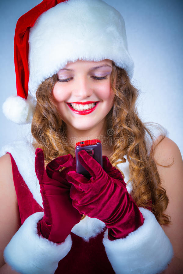 Download Female Santa Enjoying A Snowy Christmas And Cellular Stock Image - Image: 28226647