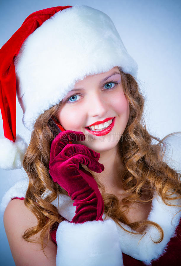 Download Female Santa Enjoying A Snowy Christmas And Cellular Royalty Free Stock Photo - Image: 28226725
