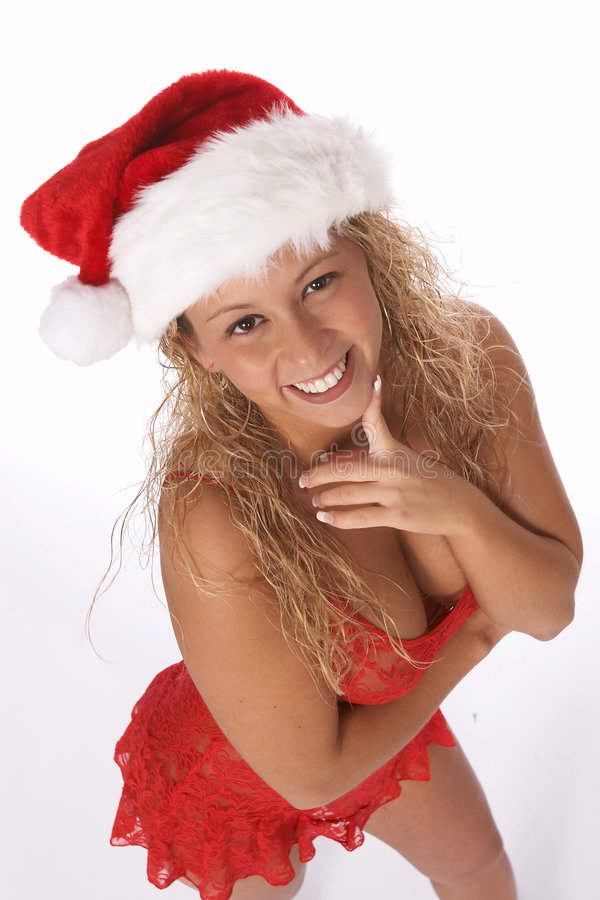 Download Female Santa In Red Baby Doll Lingerie And Hat Looking Up At Camera Stock Photo - Image: 1419510