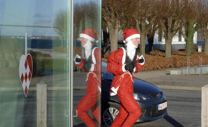Female Santa Running royalty free stock photography