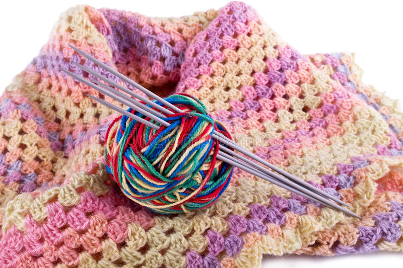 Female scarf and ball of threads. Knitted women's warm clothes isolated on white background royalty free stock images