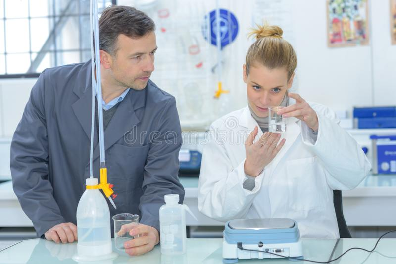 Female scientist doing experiments in lab royalty free stock photos