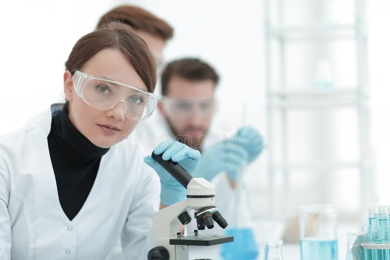 Female scientist in a laboratory. stock photography