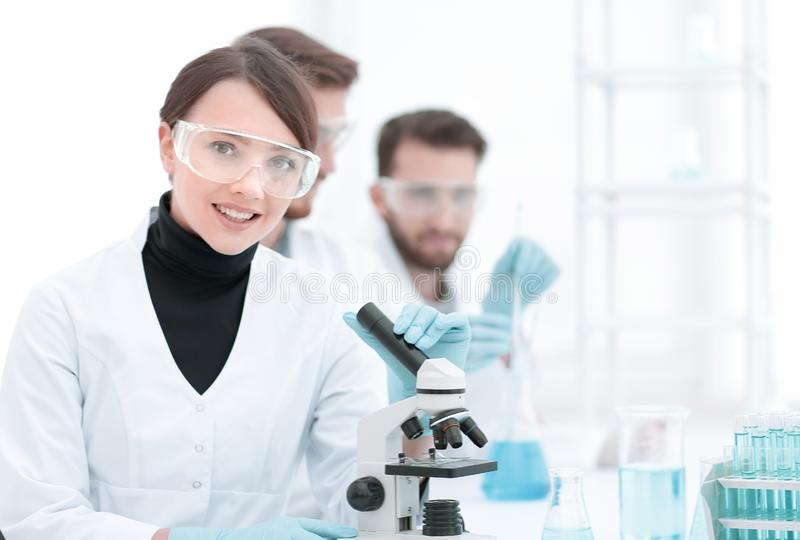 Female scientist in a laboratory. stock photos