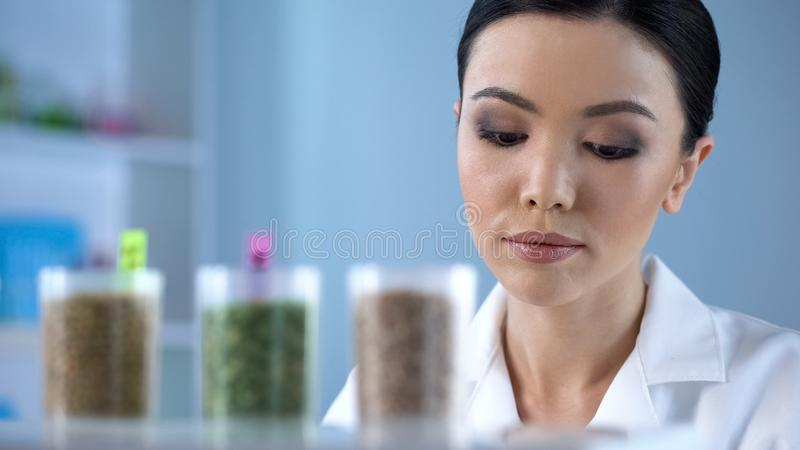 Female scientist making research of herbs properties, organic cosmetology stock photo