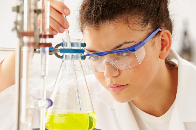 Female Scientist Studying Liquid In Flask stock photo