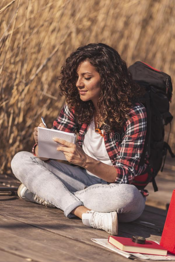 Female scientist taking notes during field work royalty free stock images