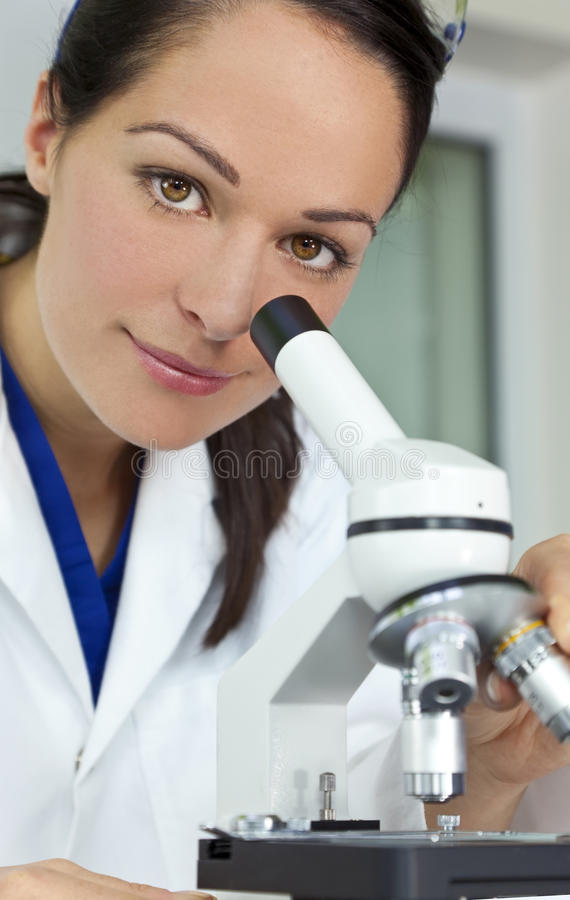 Download Female Scientist Using Microscope In Laboratory Royalty Free Stock Photo - Image: 15678725