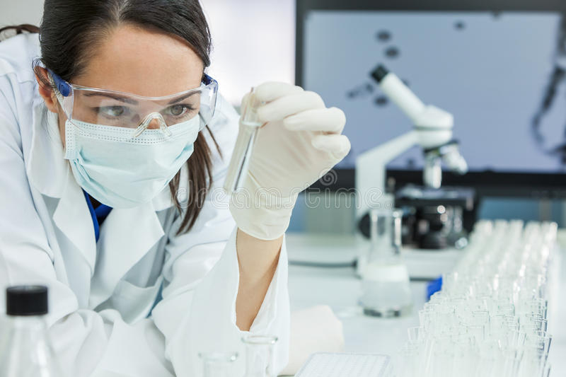 Female Scientist or Woman Doctor With Test Tube In Laboratory royalty free stock images