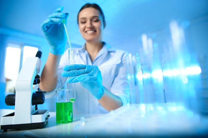 Female scientist working with sample in chemistry laboratory. Female scientist working with sample in modern chemistry laboratory royalty free stock photos
