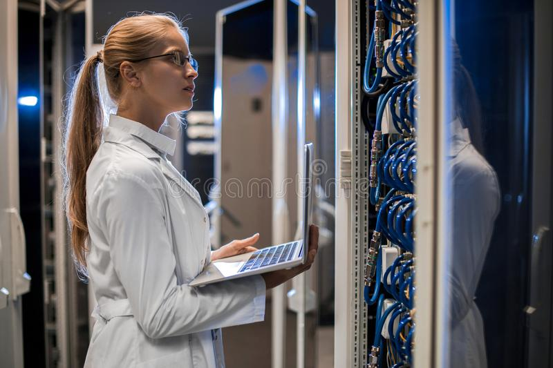 Female Scientist Working with Supercomputer royalty free stock photos