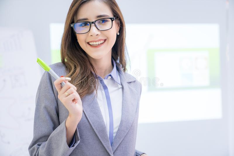 Female secretary, Young business woman presentation in the meeting room royalty free stock photo