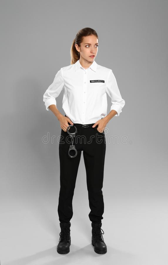 Female security guard in uniform on  background royalty free stock photography