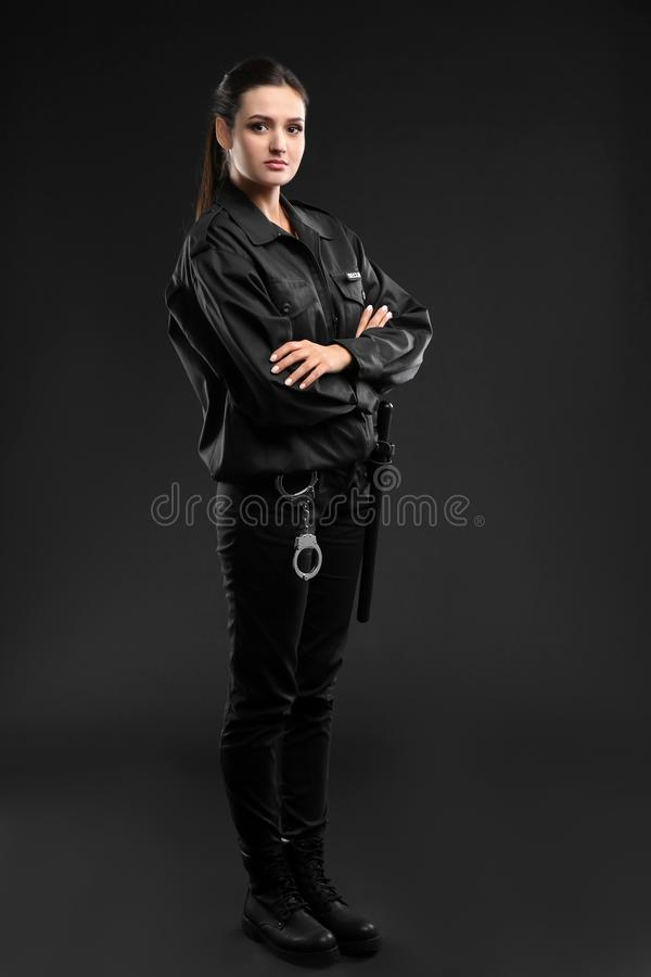 Female security guard in uniform. On dark background royalty free stock image