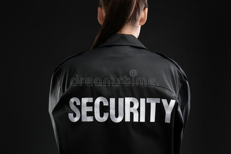 Female security guard in uniform. On dark background, closeup royalty free stock photos