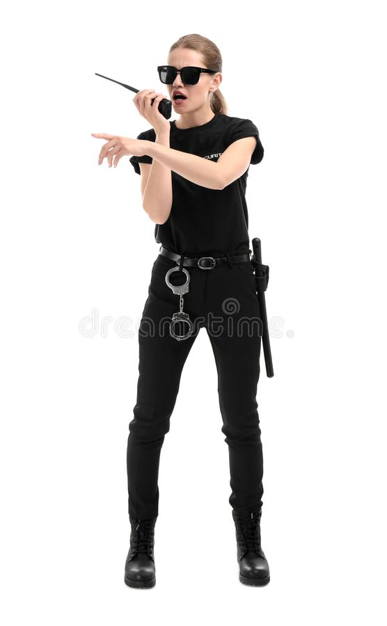 Female security guard using portable radio transmitter. On white background stock photography