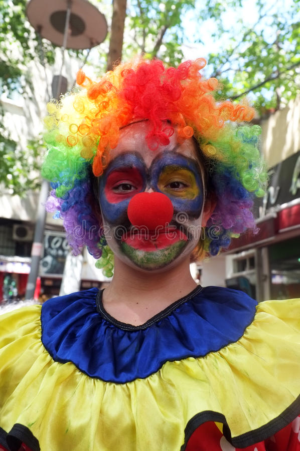 Female seller in clown dress royalty free stock images