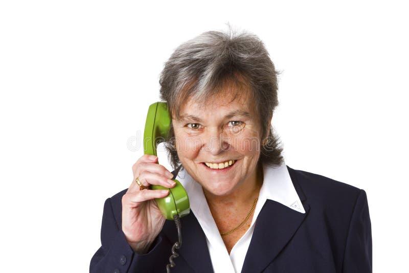 Female senior boss on telephone stock image