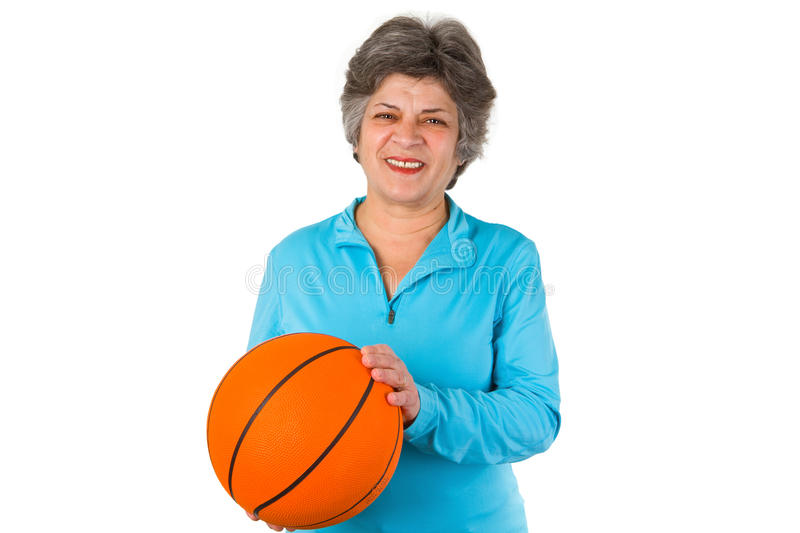 Female senior holding basketball royalty free stock images